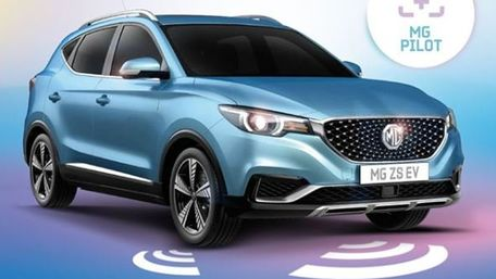 Front and side view of MG ZS EV in Pimlico Blue Metallic featuring MG Pilot