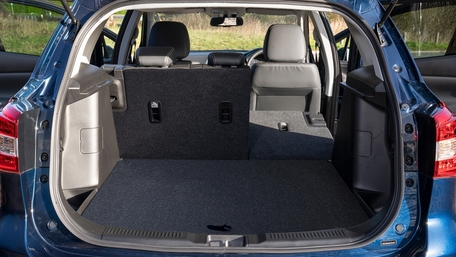 Rear view of inside of boot in Suzuki SX4 S-Cross  inn Sphere Blue Metallic showing 875L of space with rear seats folded flat