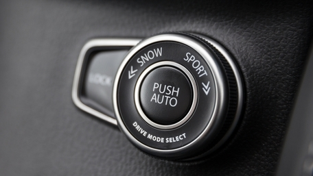 Interior of Suzuki SX4 S-Cross showing Select button to switch to 4 Wheel Drive mode according to road conditions