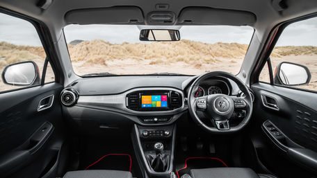 "Interior view of MG3 showing leather stitched steering wheel, 8"" touchscreen multimedia unit, DAB Radio and Appple Car play."
