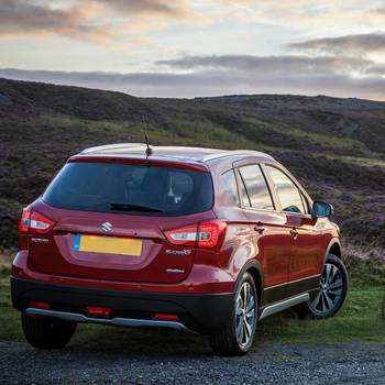 Rear View of Suzuki SX4 S-Cross  in Energetic Red Metallic in the countryside