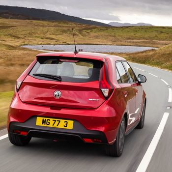 Rear View of MG3 in Ruby Red Metallic driving on country roads