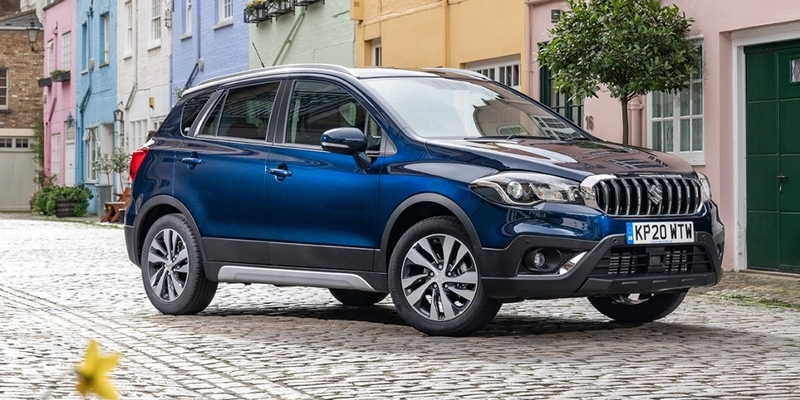 New Suzuki SX4 S-Cross SZ5 Hybrid in Sphere Blue parked on a cobbled street with colourful houses